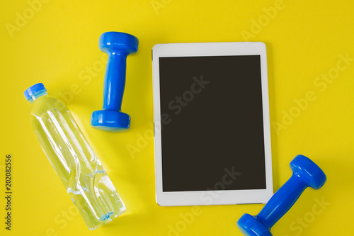 Foto Murales Sport flat lay composition tablet blue dumbbells bottle of water