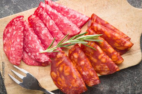 Foto Murales Slices of chorizo salami sausage.