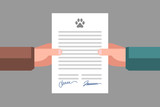 Signing of pet adoption or sale agreement