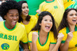 Quadro Cheering brazilian soccer fans with flag at stadium