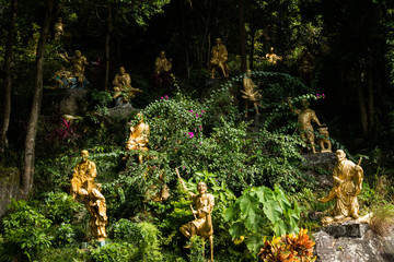 Buddha statues amongst the foilage at the Ten Thousand Buddhas Monastery, Hong Kong Asia
