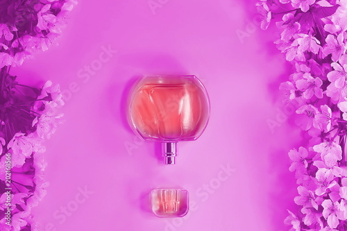 Leinwanddruck Bild bottle of cosmetic liquid. flowering branch. concept of beauty. toned background.
