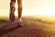 Leinwandbild Motiv Joggen auf Feldweg im Morgennebel