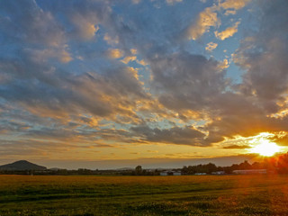Beautiful sunset landscape with sunset and blue sky with clouds