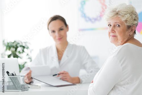 Smiling dietician's patient