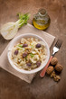 fennel salad with parmesan cheese flakes black olives and nuts - 202187996