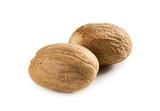 Two nutmeg isolated on white background - 202192514