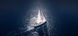 Amazing view to Yacht sailing in open sea at windy day. Drone view - birds eye angle. - 202193191