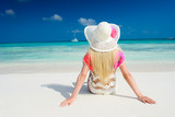 Girl on the beach at sunny day - 202193905