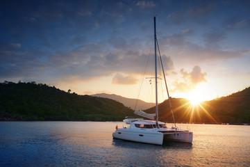 Yacht - Catamaran in the tropical sea at sunset
