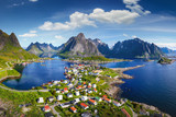 Reine, Lofoten, Norway. The village of Reine under a sunny, blue sky, with the typical rorbu houses. View from the top - 202194352