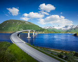 Norway famous bridge with mountains in background. Beautiful road over river in nature. - 202194377