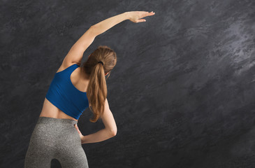 Young woman warming up before training, back view © Prostock-studio