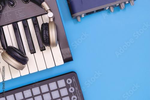 Fotobehang Muziek DJ home studio equipment top view with blue copy space