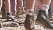 Постер, плакат: Slow motion footage feet of people dancing in a nature trance party