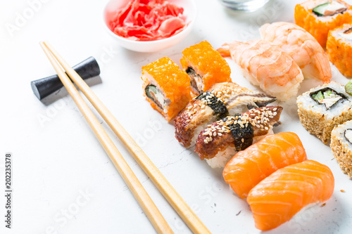 Fotobehang Sushi bar Sushi and sushi roll set on white table.