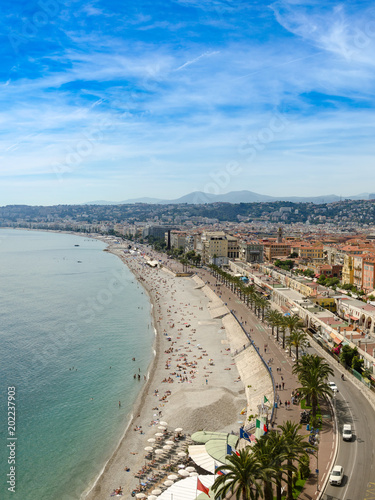 Plexiglas Nice Luxury resort of French riviera. Beautiful panorama city of Nice in France. Sunny, summer day. Mediterranean sea, public beach, famous quay, palms and houses of Nice