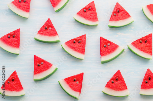 Red watermelon slice pattern on blue wooden background - 202240538