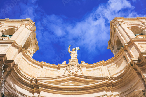Valletta, Malta, St Johns cathedral on blue sky background, under view Photo by Rawf8