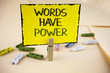 Writing note showing  Words Have Power. Business photo showcasing Statements you say have the capacity to change your reality written on Yellow Sticky Note Paper on plain background Wooden Clips.