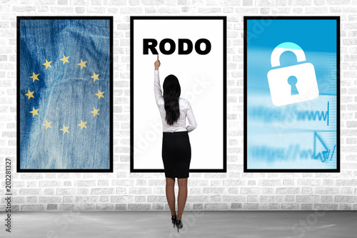 RODO concept. Woman shows on General Data Protection Regulation. New EU law from 2018.