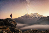 Photographer traveler who take a picture of starry sky  and sunrise in mountains - 202294176