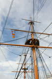 Tall mast on old ship with rigging - 202299941