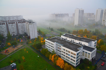 Autumn city landscape with fog in Moscow, Russia