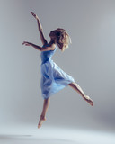Young beautiful ballerina is posing in studio - 202342777