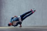 Young beautiful male dancer posing in studio - 202345735