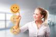 Leinwandbild Motiv junge Frau wählt freudigen Smiley vor modernem Bürohintergrund