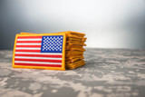 American flags stacked on camouflage - 202373345