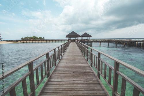 Wooden Pier at Tropical Beach