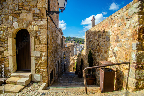 view of the old tower on the street of Tossa de Mar, Spain