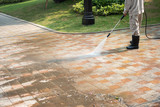 Outdoor floor cleaning with a pressure water jet on street - 202435129