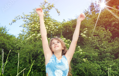 girl with raised arms