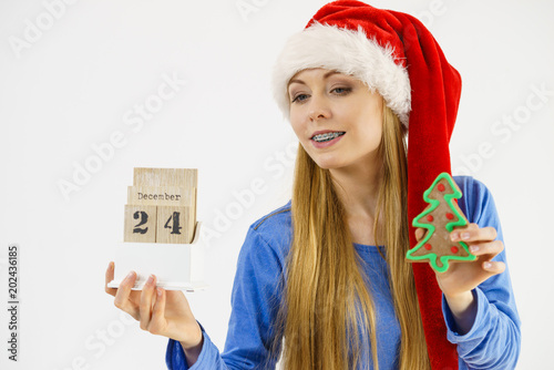 Christmas woman holding calendar and tree