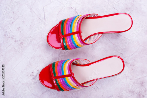 Red sandals with colored stripes