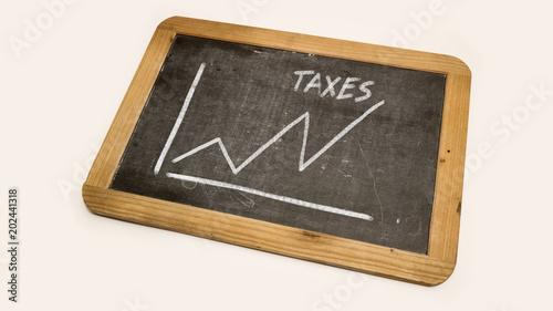 tax scheme is drawn on a blackboard