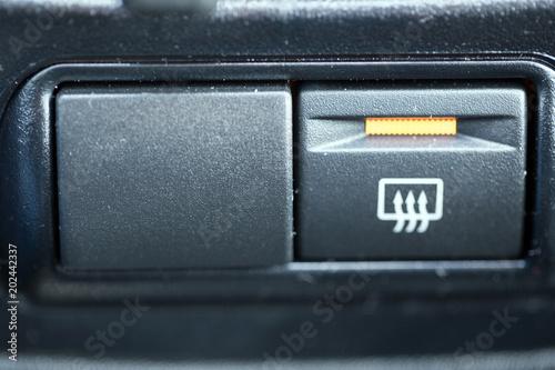 Rear window heating button