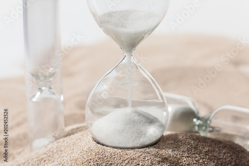 Time as sand. Hourglass in the desert