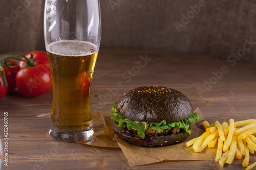 a glass of beer with a burger