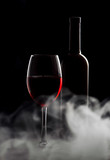 Glass with red wine on a black background - 202461575