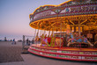 Carousel on Brighton beach at sunset.