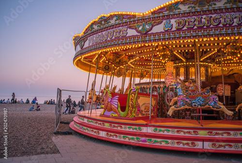 Carousel on Brighton beach at sunset.