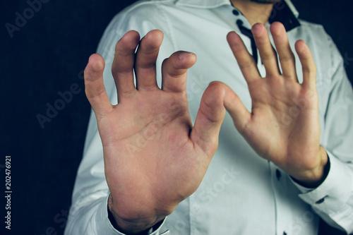 Man doing stop gesture.