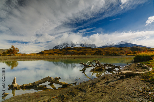 View of the mountains and the river in Torres del Paine National Park. Autumn in Patagonia, the Chilean side