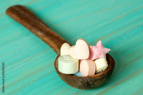 Spoon with assorted little candies