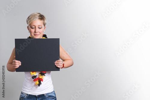 German female fan, holding black score board