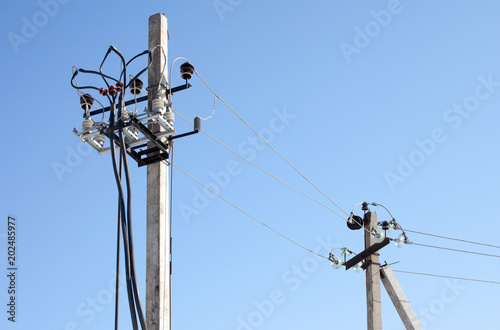 Electricity power pole with many wires and blue sky